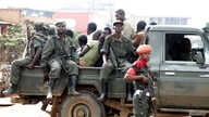 Congolese soldiers are seen on a pick-up truck after dispersing civilians protesting against what they say is the government's failure to stop killings and inter-ethnic tensions in the town of Butembo, North Kivu province, DRC, Aug. 24, 2016.