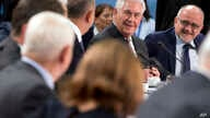 U.S. Secretary of State Rex Tillerson (rear second right) speaks with Turkish Foreign Minister Mevlut Cavusoglu (rear third right) during a meeting of the North Atlantic Council at NATO headquarters in Brussels, March 31, 2017.