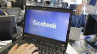 This Feb. 8, 2012, file photo, shows a view inside Facebook headquarters in Menlo Park, Calif. Facebook announced Tuesday, Oct. 22, 2013, it was working on new ways to keep users from stumbling across gruesome content on its website following an outc