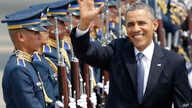 U.S. President Barack Obama waves to the media upon arrival Monday, April 28, 2014 at the Ninoy Aquino International Airport in Manila, Philippines. Trade and security are expected to be discussed in Obama's state visit to the Philippines. (AP Photo/