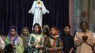 Pakistani Christians attend Easter service at Sacred Heart Cathedral, in Lahore, Pakistan, April 1, 2018.