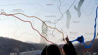 People look at a map of the border area between North and South Koreas at the Imjingak Pavilion near the border village of Panmunjom, which has separated the two Koreas since the Korean War, in Paju, north of Seoul, South Korea, Monday, Jan. 11, 2016...