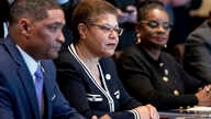 From left, Congressional Black Caucus Chairman Rep. Cedric Richmond, D-La., Rep. Karen Bass, D-Calif., Rep. Gwen Moore, D-Wis., and other members of the Congressional Black Caucus meet with President Donald Trump in the Cabinet Room of the White Hous