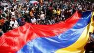 Anti-government demonstrators wave a Venezuelan flag during a protest against Venezuela's President Nicolas Maduro in Caracas, Aug. 12, 2017.
