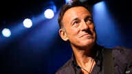 Musician Bruce Springsteen stands on stage at the Stand Up for Heroes event at Madison Square Garden, Nov. 7, 2013, in New York.