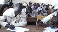 South Sudanese children sit an exam in a high school in Aweil on March 20, 2013. (VOA/Hou Akot Hou)