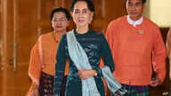 National League for Democracy party (NLD) leader Aung San Suu Kyi, center, arrives at Myanmar's parliament in Naypyitaw, Myanmar, March 15, 2016.