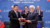 Chinese Premier Li Keqiang, European Council President Donald Tusk and European Commission President Jean-Claude Juncker stand behind Zhang Jianhua, Chinese Minister of Energy and European Commissioner for Climate Action and Energy Miguel Arias Canet...