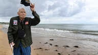 US WWII veteran Loren Kissick from Puyallup, Washington, stands on Omaha Beach in Saint-Laurent-sur-Mer, Normandy, north-western