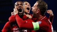 Soccer Football - Champions League Semi Final Second Leg - Liverpool v FC Barcelona - Anfield, Liverpool, Britain - May 7, 2019  Liverpool's Georginio Wijnaldum celebrates scoring their third goal with Jordan Henderson and Trent Alexander-Arnold   RE...