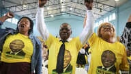 Supporters cheer South African President Cyril Ramaphosa during an election rally for ruling African National Congress (ANC) ahead of the May 8th general election, in Mitchells Plain near Cape Town, South Africa, May 3, 2019.