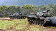 Military tanks advance during a military exercises in Hualien, eastern Taiwan
