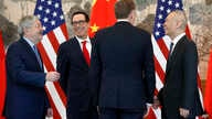 Chinese Vice Premier Liu He (R) talks with U.S. Treasury Secretary Steven Mnuchin (2nd-L), U.S. Trade Representative Robert Lighthizer (2nd-R) and U.S. Ambassador to China Terry Branstad (L) after concluding their meeting at the Diaoyutai State Guest...