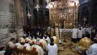 Catholics Christians pray in Church of the Holy Sepulchre, traditionally believed by many to be the site of the crucifixion of Jesus Christ, during Easter Sunday procession in Jerusalem's old city, April 21, 2019.