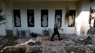 A policeman walks past a damaged window after riots following the announcement of last month's presidential election results at the Election Supervisory Agency (Bawaslu) headquarters in Jakarta, Indonesia, May 23, 2019.