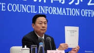 """Guo Weimin, Vice Director of the Information Office of China's State Council holds a white paper titled """"China's Position on the China-US Economic and Trade Consultations"""" at a news conference in Beijing, June 2, 2019."""