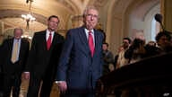 FILE - Senate Majority Leader Mitch McConnell, R-Ky., Sen. James Inhofe, R-Okla., a member of the Senate Armed Services Committee (far-L) and Sen. John Barrasso, R-Wyo., (2nd-L) arrive for a news conference on Capitol Hill in Washington, June 12, 2018.
