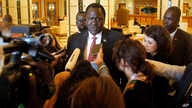 FILE - South Sudan's Minister of Petroleum Ezekiel Lol Gatkuoth speaks to reporters in the lobby of his residence hotel in Jiddah, Saudi Arabia, May 18, 2019.