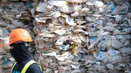 FILE - A container is filled with plastic waste from Australia, in Port Klang, Malaysia, May 28, 2019.