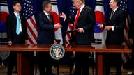President Donald Trump hands a pen to South Korean President Moon Jae-In during a signing ceremony for the United States-Korea Free Trade Agreement during the United Nations General Assembly, Monday, Sept. 24, 2018, in New York.