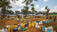 Empty jerrycans are arranged by refugees from Burundi who fled the ongoing violence and political tension at a water tap at the Nyarugusu refugee camp in western Tanzania, May 28, 2015.