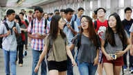FILE - Students arrive for the first day of school at Stuyvesant High School in New York, Sept. 9, 2015.