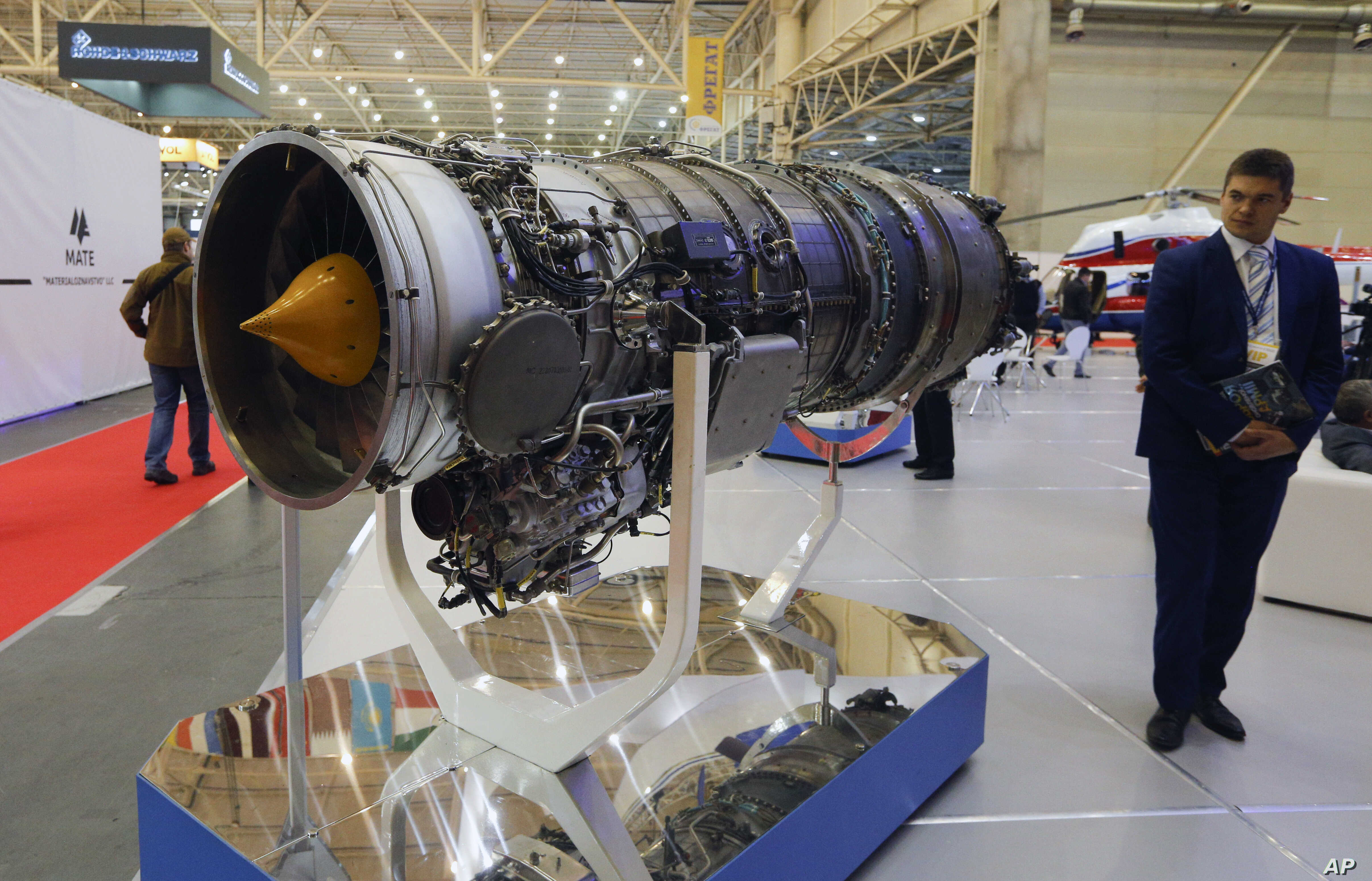 FILE - A visitor looks at a turbofan AI-322F engine for combat trainers and light combat aircraft made by Ukraine's Motor Sich manufacturer at an international weapons exhibition in Kyiv, Ukraine, Oct. 9, 2018.