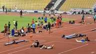 Athletes exercise during an evening training session prior the start of the World Athletics Championships in Doha, Qatar, Sept. 25, 2019.