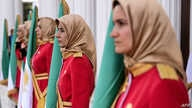 """Mujahedin-e Khalq honor guard stand guard during a welcoming ceremony for personalities taking part in the conference """"120…"""