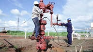 Workers are seen at an oil well at the Toma South oil field to Heglig, in Ruweng State, South Sudan August 25, 2018.