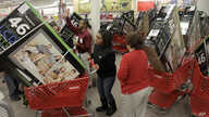 File — Early bird shoppers snatch up flat screen televisions at the Target store in Mayfield Hts., Ohio, on Black Friday.