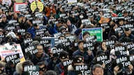 FILE - Demonstrators supporting the MeToo movement in black stage a rally to mark the International Women's Day in Seoul, South Korea, March 8, 2018.