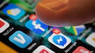 FILE - In this Aug. 11, 2019, file photo an iPhone displays the apps for Facebook and Messenger in New Orleans. Facebook says…