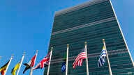 Flags fly outside the United Nations headquarters during the 74th session of the United Nations General Assembly