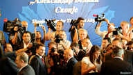 FILE - Members of the media take pictures of the former Macedonian Prime Minister Nikola Gruevski during the opening ceremony of the airport Alexander the Great in Skopje, Macedonia, June 9, 2011.