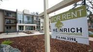 """FILE- This Jan. 8, 2017, file photo shows a """"For Rent"""" sign outside an apartment building in Sacramento, Calif."""