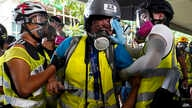FILE - In this Sept. 29, 2019, file photo, Indonesian video journalist Veby Mega Indah, center, who got injured in police…