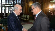 A handout picture released by the official Algeria Press Service (APS) shows Algerian President Abdelaziz Tebboune (L) receiving newly-appointed Prime Minister Abdelaziz Djerad in the capital Algiers, Dec. 28, 2019.