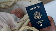 In this photo taken on Jan. 24, 2019, Denis Wolok, the father of 1-month-old Eva's father, shows the child's U.S. passport…