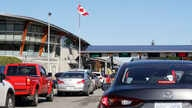 In this Oct. 9, 2019 photo, traffic enters Canada from the United States at the Peace Arch Border Crossing, in Blaine, Wash…