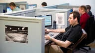 In this Feb. 24, 2015, photo, workers analyze baseball games at Baseball Info Solutions  in Coplay, Pa. Baseball Info Solutions…
