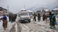 An ambulance ferries patients to a hospital through a snow-covered road in Kangan, north of Srinagar, India-controlled Kashmir, Jan. 14, 2020.