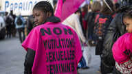 "A woman wears a jersey reading ""No to female genital mutilation"" during a demonstration to defend women's rights on…"