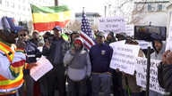 Ethiopian-Americans rally against the Trump administration's involvement in negotiations over the Great Ethiopian Renaissance Dam project, in Washington, Feb. 27, 2020. (Habtamu Seyoum/VOA)