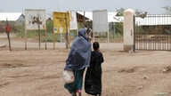 FILE - A mother and daughter walk at the Kakuma refugee camp in northern Kenya, March 5, 2018.