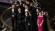 """Kwak Sin Ae and Bong Joon-ho win the Oscar for Best Picture for """"Parasite"""" at the 92nd Academy Awards in Los Angeles, Calif., Feb. 9, 2020."""