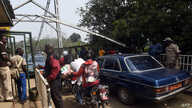Security guards check vehicles leaving Nigeria for Cameroon at a checkpoint border between Cameroon and Nigeria, in Mfum, in…