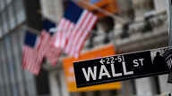 FILE - A sign for Wall Street is seen in front of the New York Stock Exchange, in New York City, Jan. 31, 2020.