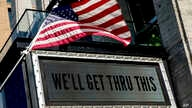 "In this April 6, 2020 photo, a sign at The Anthem music venue reads ""We'll Get Thru This"" at the wharf in D.C."