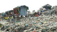 Shelters are seen amid mounds of trash at Dangkor Landfill, in Phnom Penh, Cambodia, Dec. 31, 2019. (Tum Malis/VOA Khmer)